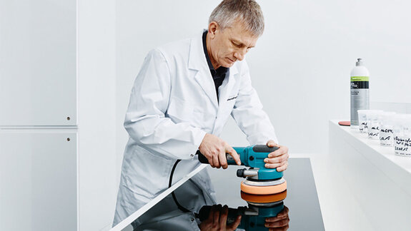 Engineer testing a Koch-Chemie product
