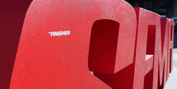 """The Finisher"" logo sticker on the SEMA Show logo display"